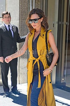 Victoria Beckham,Victoria Beckham Leaves Her Hotel In A Sleeveless Yellow Trench Coat