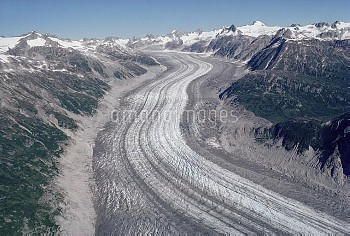 Glacier flowing between the Chigmit Mountains showing glacial valley, medial and lateral moraines, L