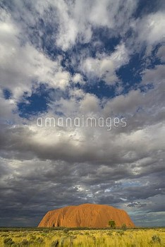 Ayers Rock and storm clouds, Uluru-kata Tjuta National Park, Northern Territory, Australia