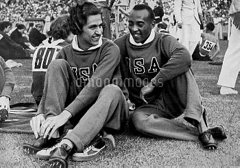 (L-R) The two 100m champions, USA's Helen Stephens and Jesse Owens, share a joke