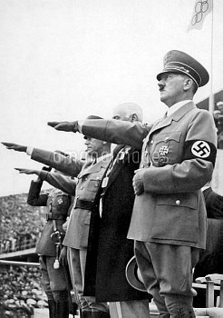 The Reichsfuhrer, Adolf Hitler, salutes the Olympic flag after officially declaring the Games open
