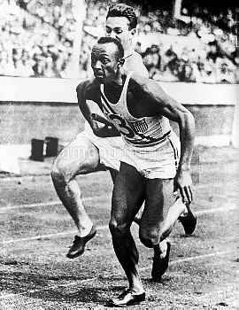 Jesse Owens takes the baton before running the third leg