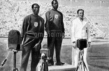 The podium: (l-r) USA's Ralph Metcalfe (silver), USA's Eddie Tolan (gold), Germany's Arthur Jonath (
