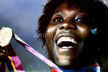 Great Britain's Tessa Sanderson celebrates with her gold medal.