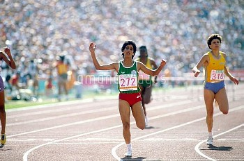 Morocco's Nawal El Moutawakel crosses the line to win  the women's 400m hurdles in a then-record tim
