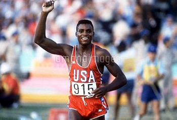 USA's Carl Lewis celebrates winning gold