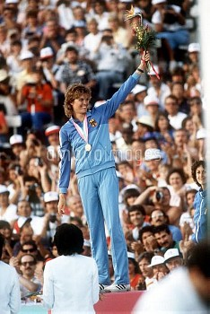 West Germany's Ulrike Meyfarth celebrates after receiving her gold medal