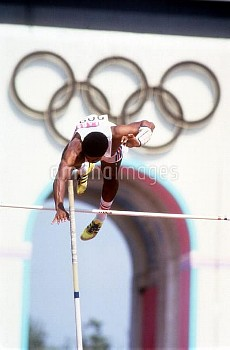 Great Britain's Daley Thompson releases the pole as he flies over the bar in the pole vault on his w