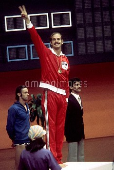 USA's John Naber flashes a victory sign to the crowd after receiving his gold medal