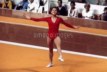 USSR's Olga Korbut performs her floor routine wearing a broad smile