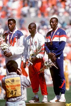 USA's Carl Lewis (l, silver) appears annoyed to have lost gold to Canada's Ben Johnson (c), while Gr