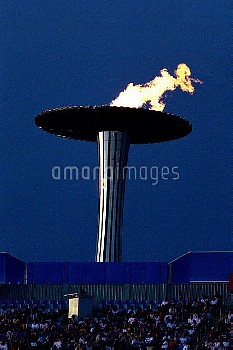 The Olympic Flame burns high above Stadium Australia
