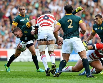 South Africa's Jean De Villiers is challenged by Japan's Michael Leitch during the Rugby World Cup m