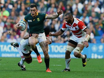 South Africa's Jesse Kriel (left) is challenged during the Rugby World Cup match at the Brighton Com