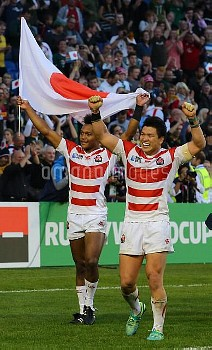 Japan players celebrate victory during the Rugby World Cup match at the Brighton Community Stadium,