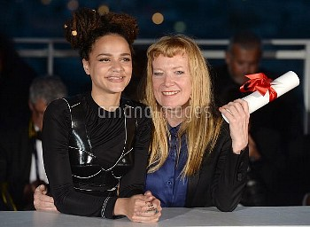 Director Andrea Arnold with Sasha Lane after being awarded the Jury Prize for the film American Hone