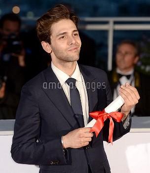 Director Xavier Dolan poses with The Grand Prix for the movie Just The End of The World at the Palme