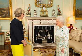 Queen Elizabeth II welcomes Theresa May at the start of an audience in Buckingham Palace, London, wh