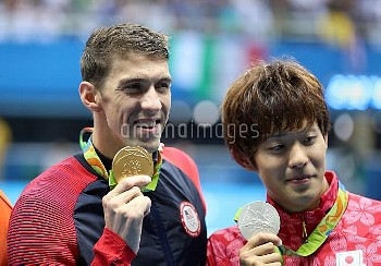 Gold medalist USA's Michael Phelps (left) and silver medalist Japan's Masato Sakai after the Men's 2