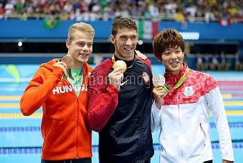 Gold medalist USA's Michael Phelps (centre) silver medalist Japan's Masato Sakai (right) and bronze
