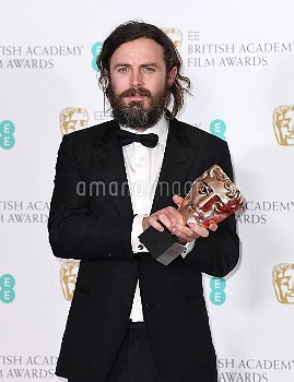 Casey Affleck with the award for Best Actor 'Manchester By The Sea' in the press room during the EE