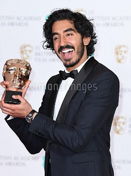 Dev Patel with the award for BEst Supporting Actor 'Lion' in the press room during the EE British Ac