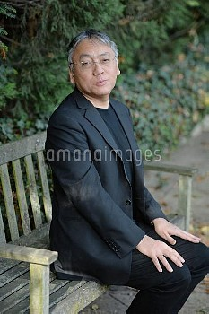 British author Kazuo Ishiguro, who has won this year's Nobel Prize In Literature, sits on a bench ou