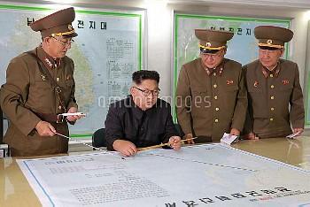 August 14, 2017 - North Korea: North Korean leader Kim Jong-Un (C) inspecting the Command of the Str