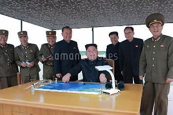 August 29, 2017 - Pyongyang, North Korea: North Korean leader Kim Jong Un, center, smiles as Kim ins