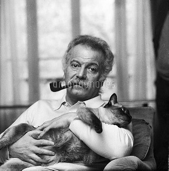 Georges Brassens (1921-1981), French singer-songwriter, at home. Paris, 1974.