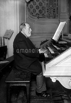 Camille Saint-Saëns (1835-1921), French composer, playing the organ. Paris, around 1905-1910.