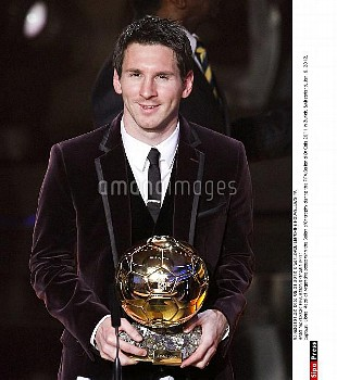 Lionel Messi of Argentina poses with the Ballon d'Or trophy during the FIFA Ballon d'Or Gala 2011 i