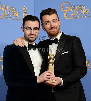 James Napier and Sam Smith win an award at the 73rd annual Golden Globe Awards in Beverly Hills