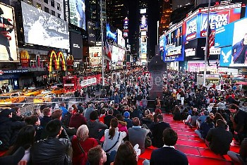 People gather in Times Square to watch election returns in New York