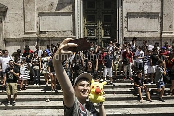 The first gathering in Rome of the Pokemon Go players Piazza del Popolo Rome Italy