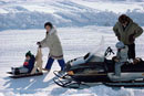 Modern Intuit family with snowmobiles