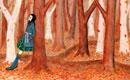 散歩道の木に寄りかかる女性