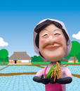 田んぼを背景に頬被り姿で稲穂を手に微笑む農家の女性