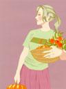 カボチャと花をかごに入れて抱えている女性