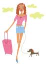 キャリーケースを持って犬と歩く女性
