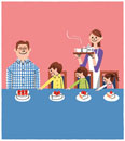 食卓にケーキを用意している家族