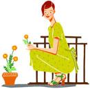 座ってお花を摘んでいる女性