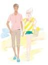 手をつないで夏の浜辺を歩くカップル