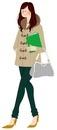 ファイルとバッグを持って歩いている女性
