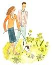 犬の散歩をしている夫婦