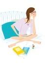 ベッドの上で本を読んでいる女性