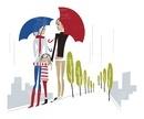 雨の日に傘をさして街で歩いている家族