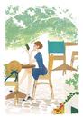 カフェで本を読みながらのんびりしている女性