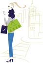 携帯を持ってショッピングをする女性