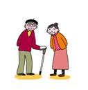 杖をつく笑顔の老夫婦